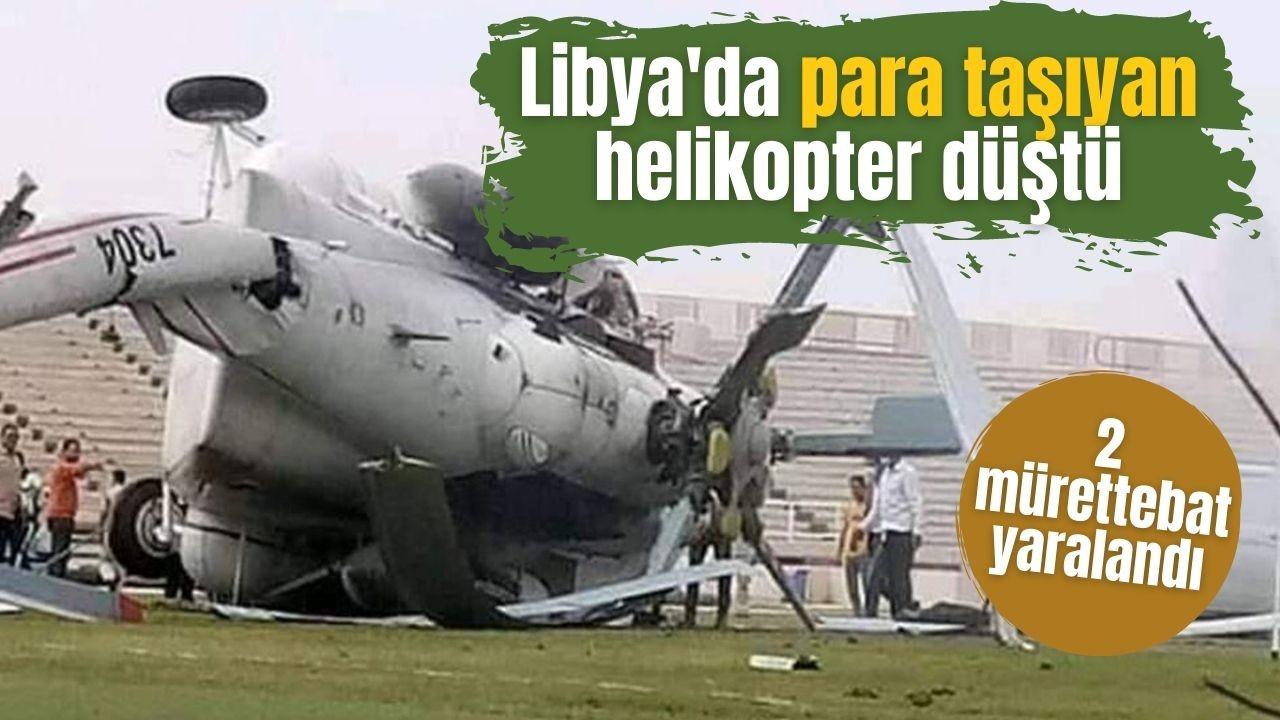 Para taşıyan helikopter acil iniş sırasında düştü